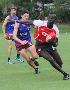 Colin O'Riordan chases down fellow defender Aliir Aliir during a training drill on Monday. - Colin O'Riordan