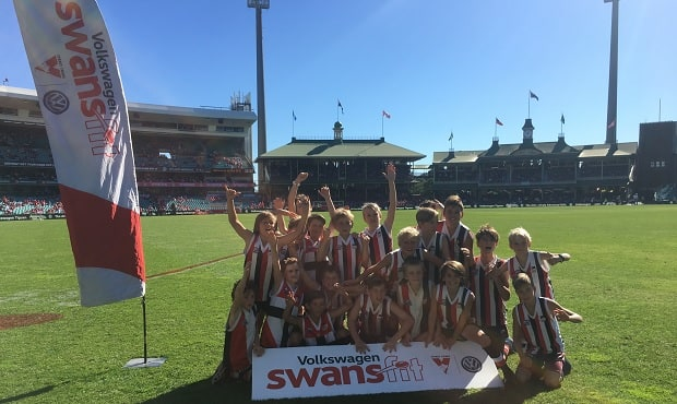 Fans enjoy a SwansFit session during half time at the SCG on Sunday.