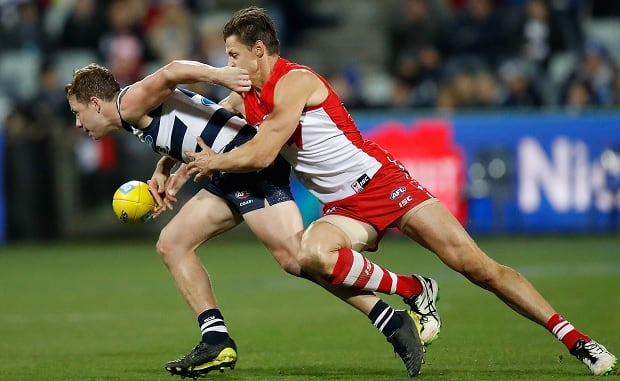 Callum Sinclair lays a strong tackle on Mitch Duncan during the Round 18 clash between the Swans and Cats. - MCG,Sydney Swans,Geelong Cats