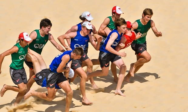 Academy participants take to the sandhills in Cronulla for training.