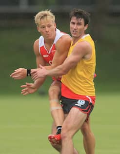 Isaac Heeney during at pre-season training with the Swans collides with Dean Towers.