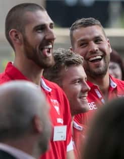 Lance Franklin shares a laugh with teammates at the 2018 Season Launch.