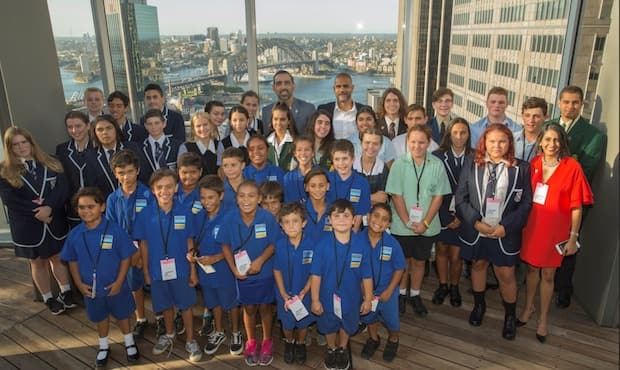 Michael O'Loughlin and Adam Goodes amongst students at the 2018 GO Foundation launch.