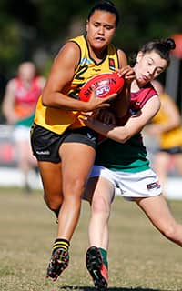 WA's Emily Macguire reels in a contested mark against the Allies