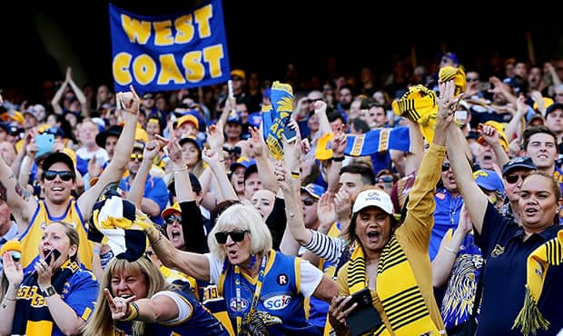 PERTH, AUSTRALIA - SEPTEMBER 22: West Coast fans celebrate the win during the 2018 AFL Second Preliminary Final match between the West Coast Eagles and the Melbourne Demons at Optus Stadium on September 22, 2018 in Perth, Australia. (Photo by Will Russell/AFL Media)