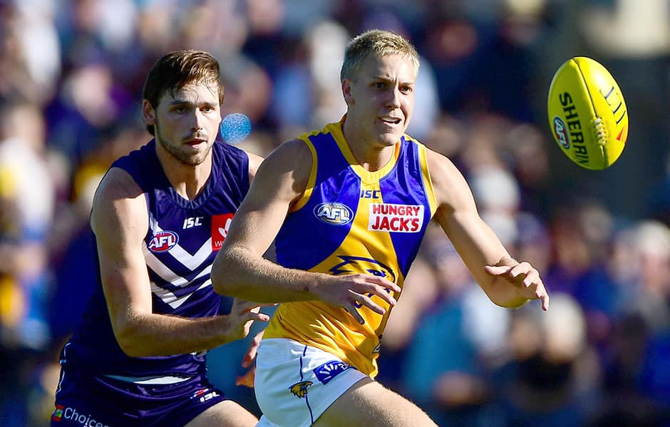 MANDURAH, AUSTRALIA - MARCH 10 : Oscar Allen of the Eagles chases down the the ball in front of Joel Hamling of the Dockers during the 2019 JLT Community Series match between the Fremantle Dockers and the West Coast Eagles at Ruston Park on March 09, 2019 in Mandurah, Australia. (Photo by Daniel Carson/AFL Media)