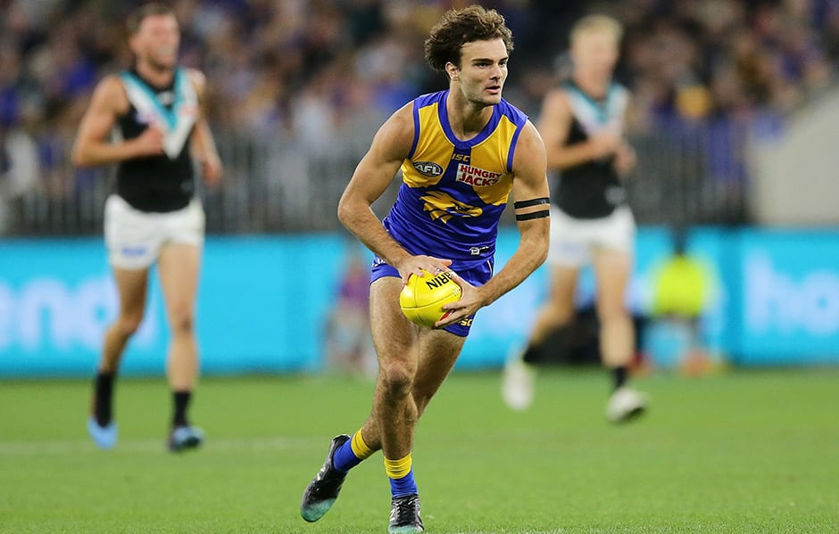 PERTH, AUSTRALIA - APRIL 19: Jack Petruccelle of the Eagles looks to pass the ball during the 2019 AFL round 05 match between the West Coast Eagles and the Port Adelaide Power at Optus Stadium on April 19, 2019 in Perth, Australia. (Photo by Will Russell/AFL Photos)