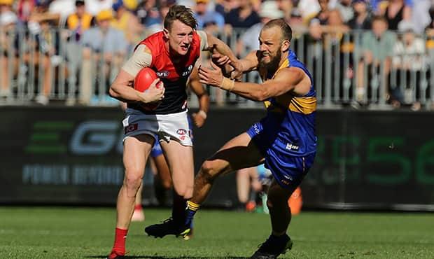 PERTH, AUSTRALIA - SEPTEMBER 22: Aaron vandenBerg of the Demons fends off Will Schofield of the Eagles during the 2018 AFL Second Preliminary Final match between the West Coast Eagles and the Melbourne Demons at Optus Stadium on September 22, 2018 in Perth, Australia. (Photo by Will Russell/AFL Media)