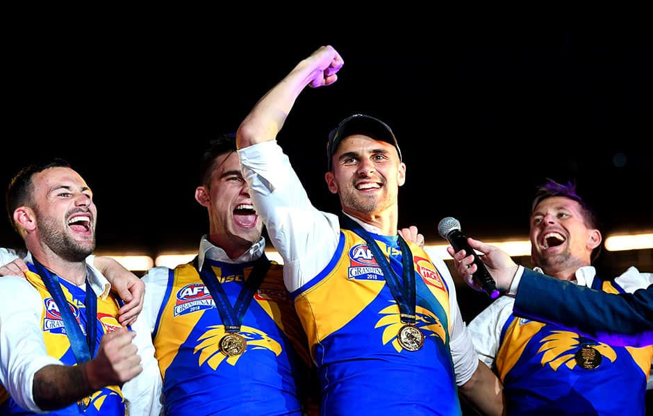 MELBOURNE, AUSTRALIA - SEPTEMBER 29: Dom Sheed, West Coast Eagles celebrates on stage in front of their fans during the 2018 Toyota AFL Grand Final match between the West Coast Eagles and the Collingwood Magpies at the Melbourne Cricket Ground on September 29, 2018 in Melbourne, Australia. (Photo by Daniel Carson/AFL Media)