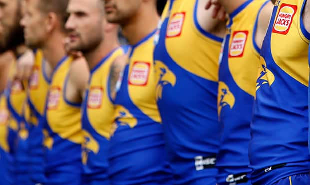 MELBOURNE, AUSTRALIA - SEPTEMBER 29: Adam Simpson, Senior Coach of the Eagles lines up with players for the national anthem during the 2018 Toyota AFL Grand Final match between the West Coast Eagles and the Collingwood Magpies at the Melbourne Cricket Ground on September 29, 2018 in Melbourne, Australia. (Photo by Adam Trafford/AFL Media)