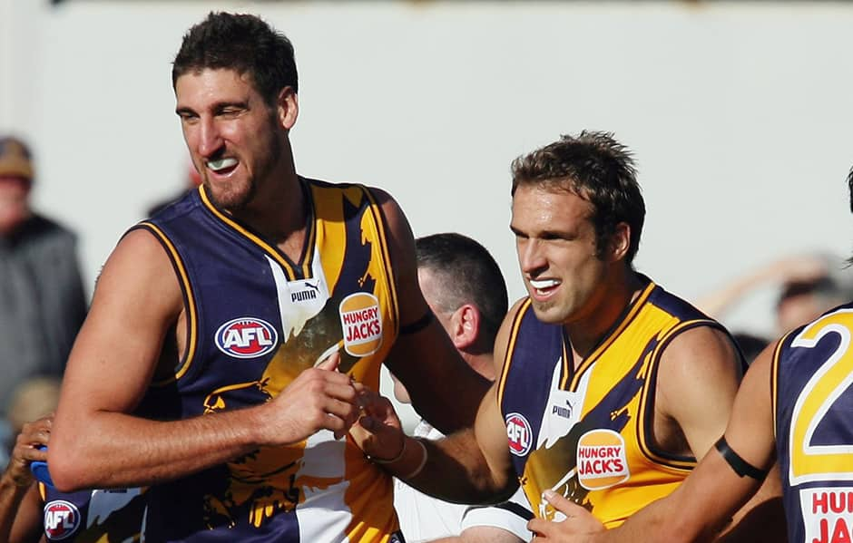 Chris Judd (C) of the Eagles celebrates with Dean Cox after scoring a goal during the round four AFL match between the Kangaroos and West Coast Eagles at Manuka Oval on April 23, 2006 in Canberra, Australia.