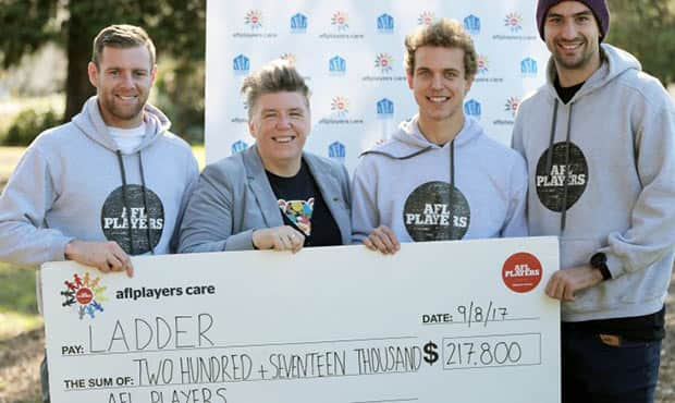 Mitch Wallis was one of three AFL players to hand over $217,800 to help combat youth homelessness in Australia.