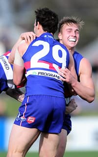 Mitch Honeychurch of Footscray celebrates with Tory Dickson of Footscray after he kicked a goal during the VFL 2nd Qualifying Final match between Footscray and Williamstown at the Whitten Oval in Melbourne on August 31, 2014. (Photo: Theo Karanikos/AFL Media)