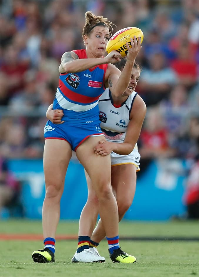 MELBOURNE, AUSTRALIA - FEBRUARY 10: Hannah Scott of the Bulldogs is tackled by Ebony Marinoff of the Crows during the 2017 AFLW Round 02 match between the Western Bulldogs and the Adelaide Crows at VU Whitten Oval on February 10, 2017 in Melbourne, Australia. (Photo by Adam Trafford/AFL Media)