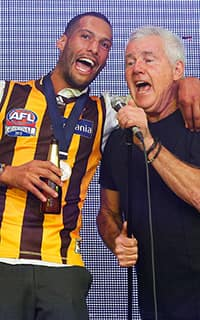 Josh Gibson and Daryl Braithwaite celebrate after Hawthorn's Grand Final win. Picture: Getty Images