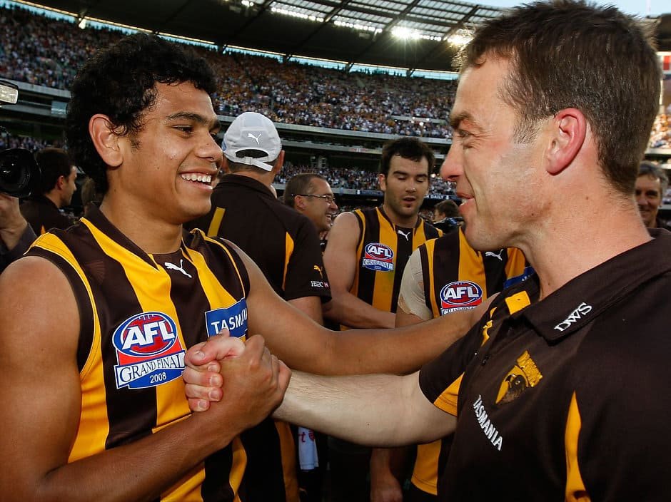 Cyril Rioli (L) & Alistair Clarkson (R) of Hawthorn celebrate after the 2008 Toyota AFL Grand Final between the Geelong Cats and the Hawthorn Hawks at the MCG.