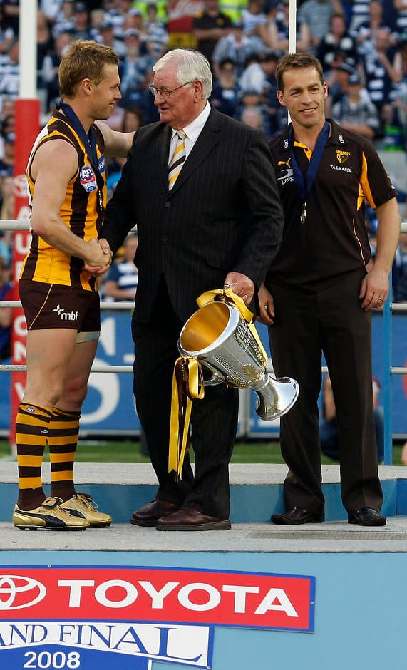 Hawthorn's Graham Arthur congratulates Sam Mitchell andAlastair Clarkson after the 2008 Toyota AFL Grand Final between the Geelong Cats and the Hawthorn Hawks at the MCG.
