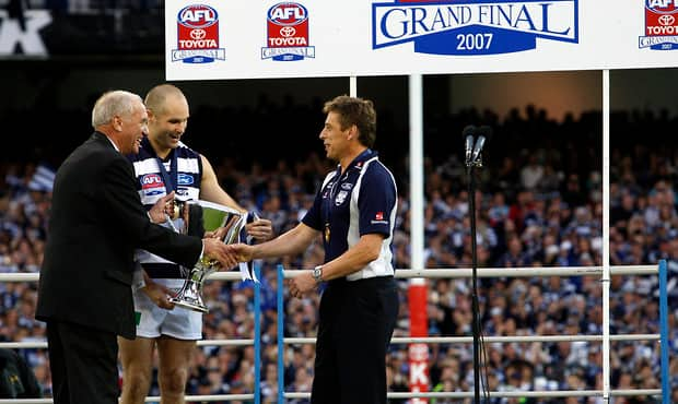 Fred Wooller presents the 2007 premiership cup to Mark Thompson and Tom Harley - Geelong Cats