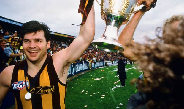 Dunstall celebrates his fourth and final premiership in 1991.