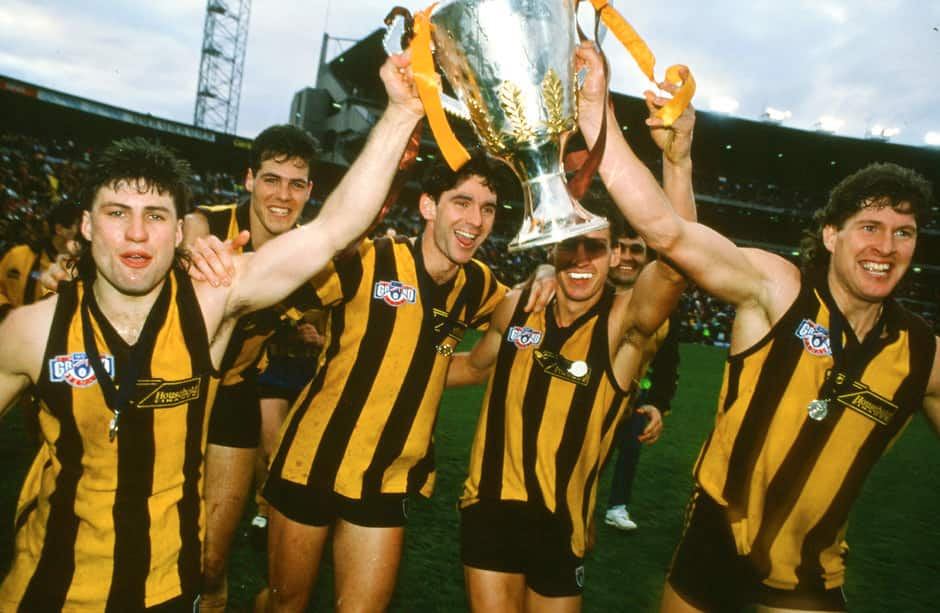 Darrin Pritchard, Stephen Lawrence, Dean Anderson, Anthony Condon and Ray Jencke of the Hawks celebrate with the Premiership Cup on their victory lap after winning the 1991 AFL Grand Final between the Hawthorn Hawks and the West Coast Eagles at Waverley Park.