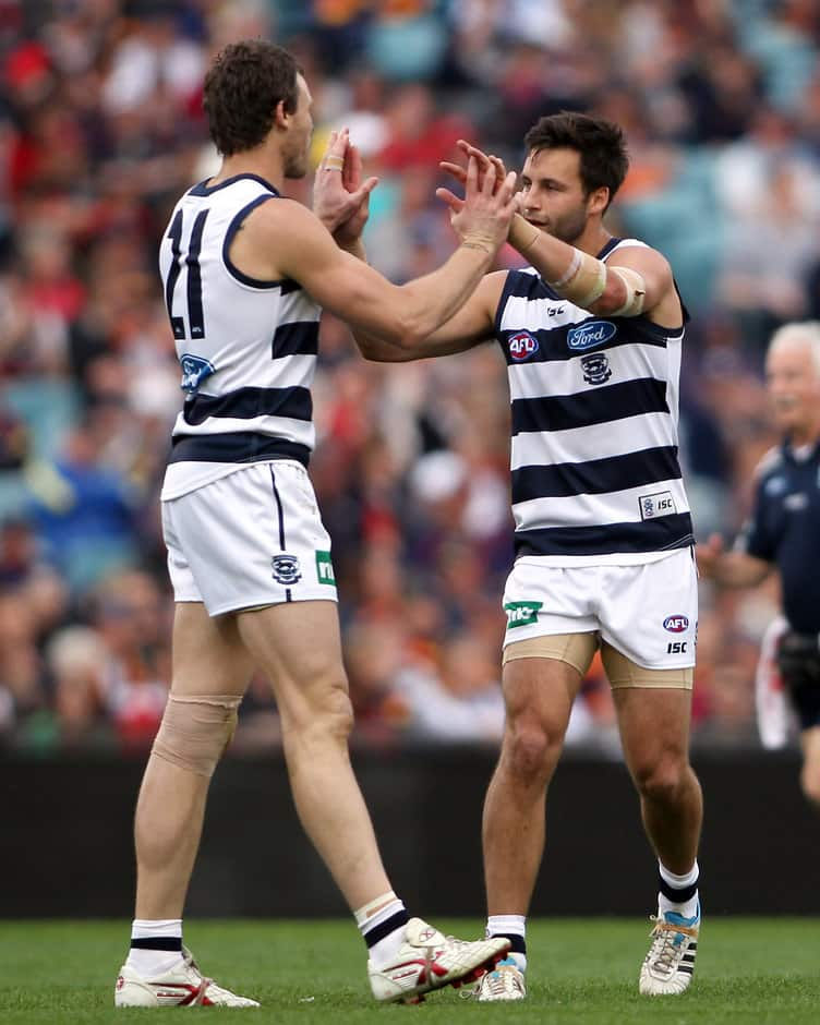 Cameron Mooney and Jimmy Bartel of the Cats celebrate a goal during the AFL  Round 21