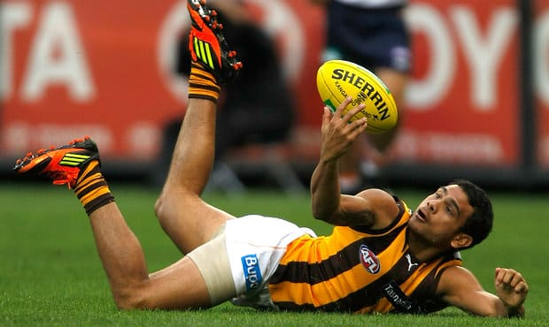 Rioli takes a spectacular grab during a 2012 home and away clash.
