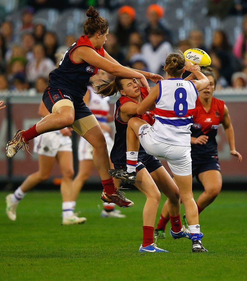 Western Bulldogs & Melbourne battle it out in the first exhibition game on June 30, 2013 at the MCG. (Photo: AFL Media) - Western Bulldogs
