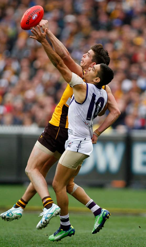 Hawthorn's Ben Stratton and Fremantle's Michael Walters compete for the ball during the 2013 Toyota Grand Final match between the Hawthorn Hawks and the Fremantle Dockers at the MCG, Melbourne on September 28, 2013. (Photo: Greg Ford/AFL Media)