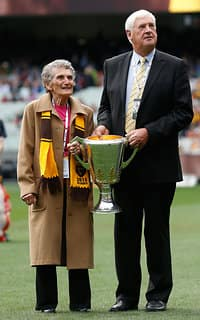 Dulcie Kennedy and Peter Hudson pose with the 2014 premiership cup.