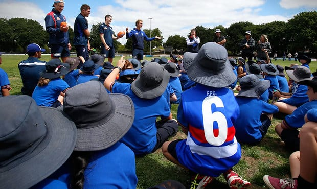BALLARAT, AUSTRALIA - FEBRUARY 16: Bulldogs players talk to students during the Western Bulldogs Community Camp clinic for Pleasant Street Primary School students at the City Oval in Ballarat, Australia on February 16, 2016. (Photo by Adam Trafford/AFL Media)