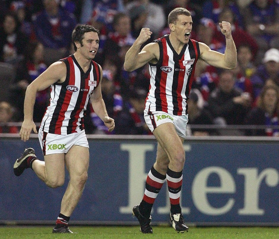Brett Voss of the Saints celebrates a goal with team mate Stephen Milne looking on during the round 21 AFL match between the Western Bulldogs and the St Kilda Saints at the Telstra Dome on August 25, 2006 in Melbourne, Australia.