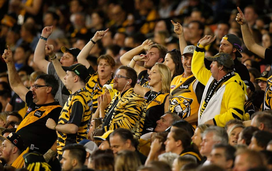 MELBOURNE, AUSTRALIA - APRIL 1: Tigers fans cheer during the 2016 AFL Round 02 match between the Collingwood Magpies and the Richmond Tigers at the Melbourne Cricket Ground, Melbourne on April 1, 2016. (Photo by Michael Willson/AFL Media)
