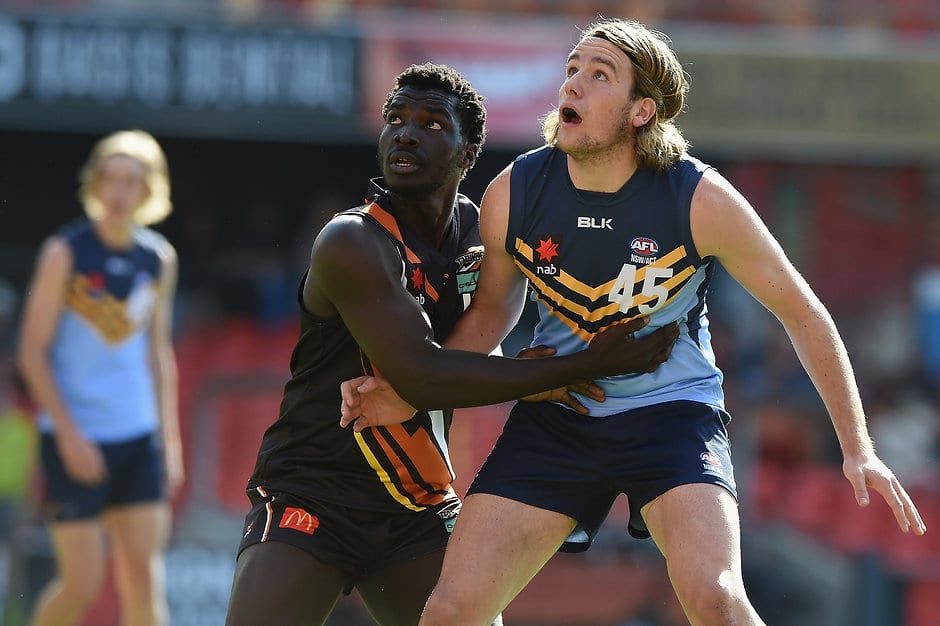 GOLD COAST, AUSTRALIA - MAY 22: Max Lynch of NSW/ACT competes for the ball against Patrick Taban of Northern Territory during the Under 18 Championship match between NSW/ACT and Northern Territory at Metricon Stadium on May 22, 2016 in Gold Coast, Australia. (Photo by Matt Roberts/AFL Media)
