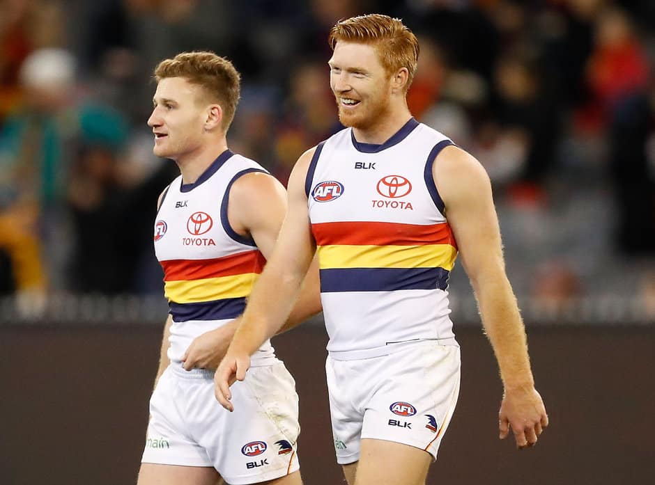 MELBOURNE, AUSTRALIA - JULY 03: Rory Laird (left) and Kyle Cheney of the Crows celebrate during the 2016 AFL Round 15 match between the Melbourne Demons and the Adelaide Crows at the Melbourne Cricket Ground on July 3, 2016 in Melbourne, Australia. (Photo by Adam Trafford/AFL Media)