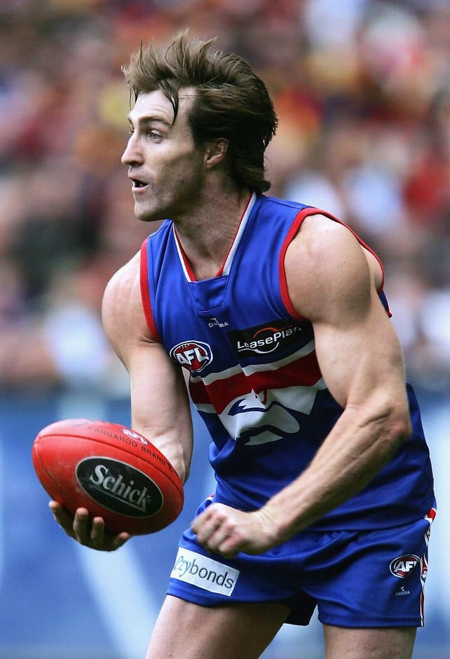 Scott West of the Bulldogs looks to handball during the round 20 AFL match between the Western Bulldogs and the Adelaide Crows at the Melbourne Cricket Ground on August 19, 2006 in Melbourne, Australia.