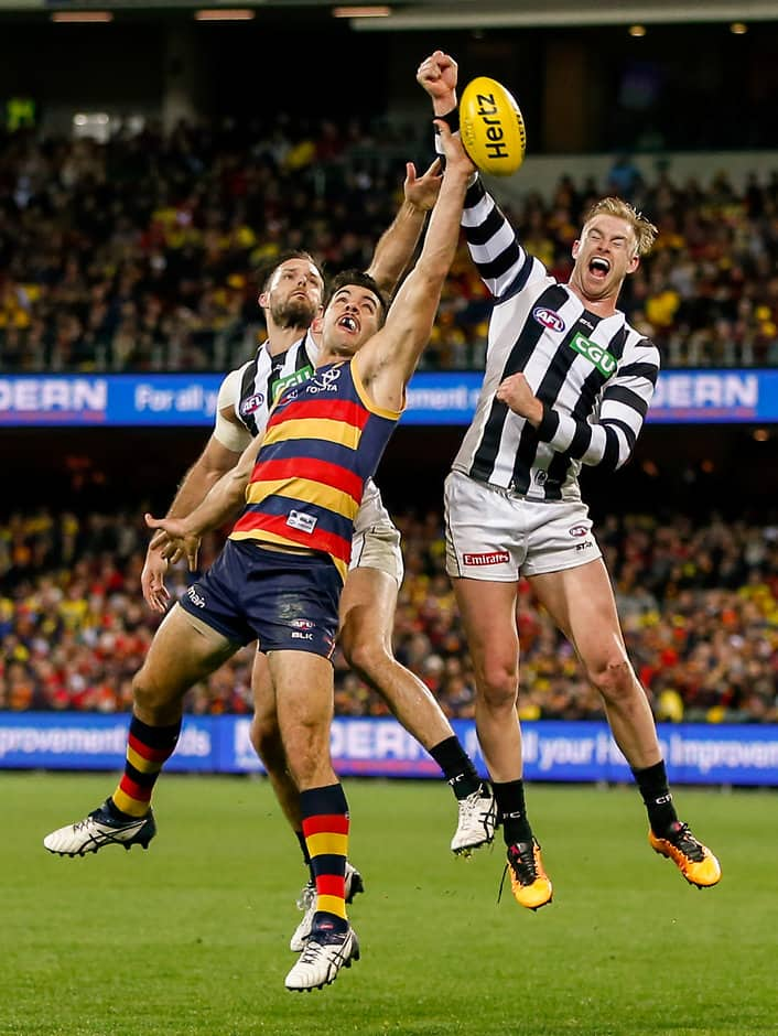 ADELAIDE, AUSTRALIA - JULY 16: Taylor Walker of the Crows clashes with Nathan Brown and Jonathon Marsh of the Magpies during the 2016 AFL Round 17 match between the Adelaide Crows and the Collingwood Magpies at the Adelaide Oval on July 16, 2016 in Adelaide, Australia. (Photo by AFL Media)