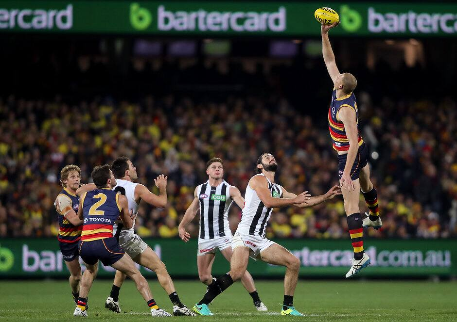 ADELAIDE, AUSTRALIA - JULY 16: Sam Jacobs of the Crows in a centre bounce clash with Brodie Grundy of the Magpies during the 2016 AFL Round 17 match between the Adelaide Crows and the Collingwood Magpies at the Adelaide Oval on July 16, 2016 in Adelaide, Australia. (Photo by AFL Media)