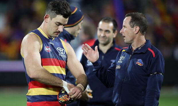 ADELAIDE, AUSTRALIA - AUGUST 06: Don Pyke, Senior Coach of the Crows with his captain Taylor Walker during the 2016 AFL Round 20 match between the Adelaide Crows and the Brisbane Lions at Adelaide Oval on August 06, 2016 in Adelaide, Australia. (Photo by AFL Media)