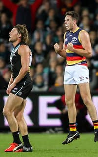 ADELAIDE, AUSTRALIA - AUGUST 20: Mitch McGovern of the Crows celebrates a goal as Brad Ebert of the Power looks on during the 2016 AFL Round 22 match between Port Adelaide Power and the Adelaide Crows at the Adelaide Oval on August 20, 2016 in Adelaide, Australia. (Photo by AFL Media)