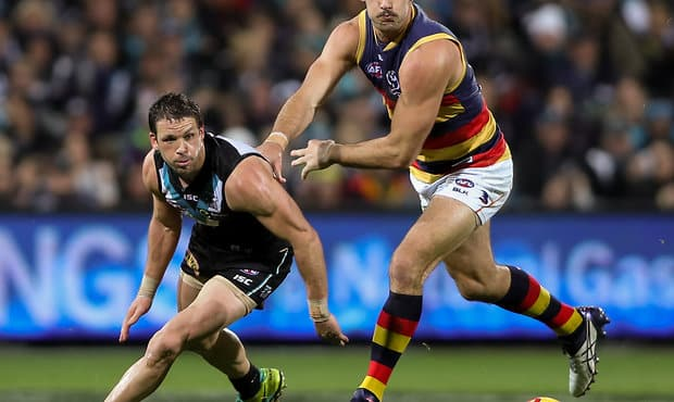 ADELAIDE, AUSTRALIA - AUGUST 20: Travis Boak of the Power clashes with Taylor Walker of the Crows during the 2016 AFL Round 22 match between Port Adelaide Power and the Adelaide Crows at the Adelaide Oval on August 20, 2016 in Adelaide, Australia. (Photo by AFL Media)