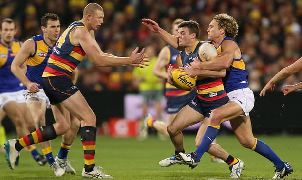 ADELAIDE, AUSTRALIA - AUGUST 26: Matt Priddis of the Eagles tackles Brad Crouch of the Crows during the 2016 AFL Round 23 match between the Adelaide Crows and the West Coast Eagles at Adelaide Oval on August 26, 2016 in Adelaide, Australia. (Photo by James Elsby/AFL Media)