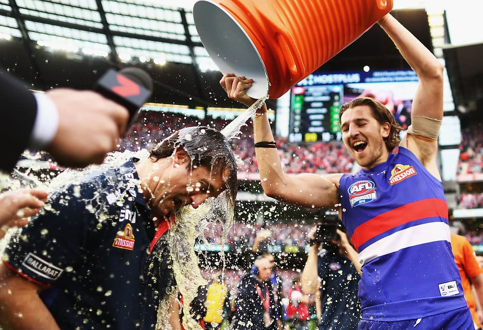 Marcus Bontempelli gives Dogs coach Luke Beveridge the Gatorade treatment after last year's fairytale premiership - AFL,AFL Players' Top 50,Marcus Bontempelli,Western Bulldogs