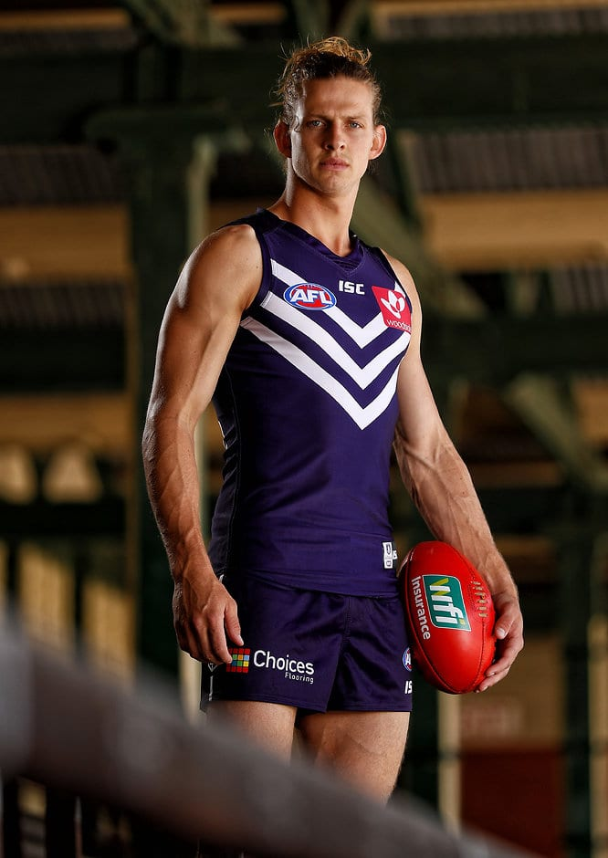 PERTH, AUSTRALIA - DECEMBER 13: Nat Fyfe poses for a photograph during the Fremantle Dockers 2017 official team photo day at Fremantle Oval in Perth, Australia on December 13, 2016. (Photo by Michael Willson/AFL Media)