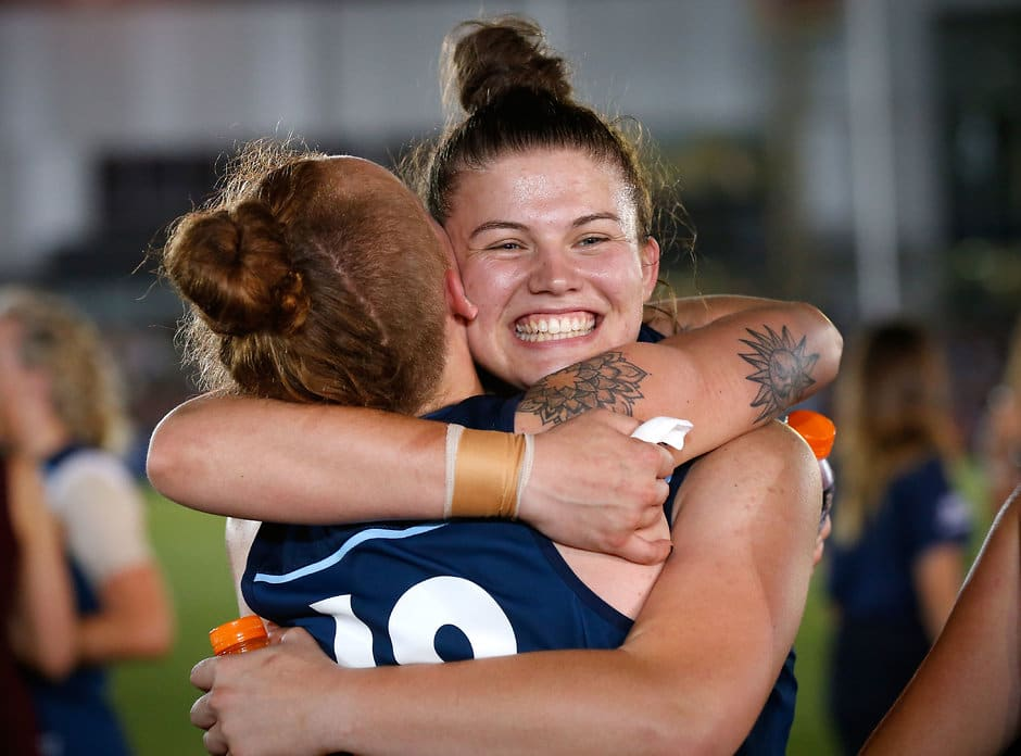 MELBOURNE, AUSTRALIA - FEBRUARY 3: Bella Ayre of the Blues (right) hugs Tilly Lucas-Rodd of the Blues during the 2017 AFLW Round 01 match between the Carlton Blues and the Collingwood Magpies at Ikon Park on February 3, 2017 in Melbourne, Australia. (Photo by Adam Trafford/AFL Media)