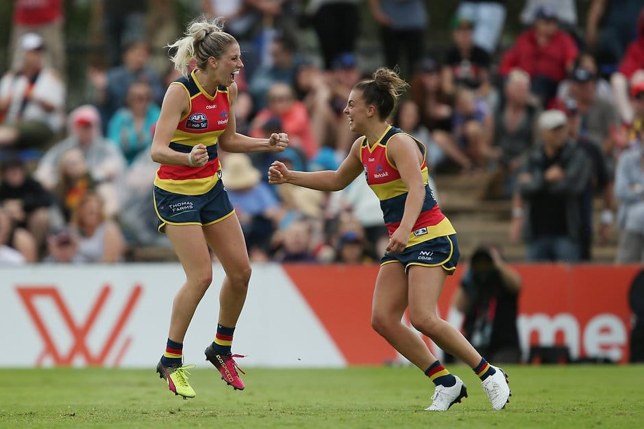 ADELAIDE, AUSTRALIA - FEBRUARY 4: Deni Varnhagen and Ebony Marinoff of the Crows celebrate a goal during the 2017 AFLW Round 01 match between the Adelaide Crows and the GWS Giants at Thebarton Oval on February 4, 2017 in Adelaide, Australia. (Photo by James Elsby/AFL Media)