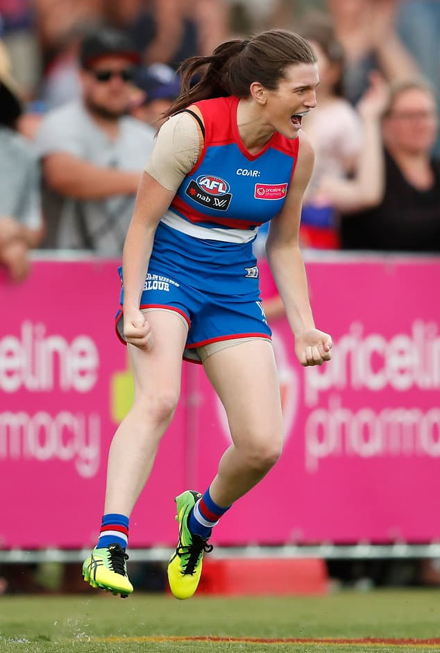 MELBOURNE, AUSTRALIA - FEBRUARY 4: Kirsten McLeod of the Bulldogs celebrates the first goal of the match during the 2017 AFLW Round 01 match between the Western Bulldogs and the Fremantle Dockers at VU Whitten Oval on February 4, 2017 in Melbourne, Australia. (Photo by Adam Trafford/AFL Media)