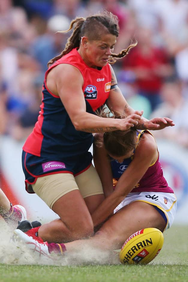 MELBOURNE, AUSTRALIA - FEBRUARY 05:  Richelle Cranston of the Demons crunches Jamie Stanton of the Lions during the round one Women's AFL match between the Melbourne Demons and the Brisbane Lions at Casey Fields on February 5, 2017 in Melbourne, Australia.  (Photo by Michael Dodge/Getty Images/AFL Media)
