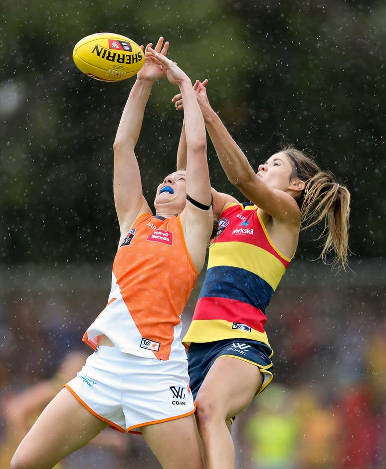 ADELAIDE, AUSTRALIA - FEBRUARY 4: Ashleigh Guest of the Giants clashes with Monique Hollick of the Crows during the 2017 AFLW Round 01 match between the Adelaide Crows and the GWS Giants at Thebarton Oval on February 4, 2017 in Adelaide, Australia. (Photo by AFL Media)