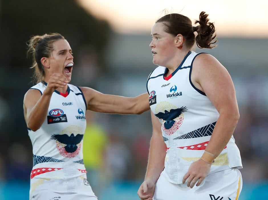 MELBOURNE, AUSTRALIA - FEBRUARY 10: Sarah Perkins of the Crows (bottom) celebrates a goal with Chelsea Randall of the Crows during the 2017 AFLW Round 02 match between the Western Bulldogs and the Adelaide Crows at VU Whitten Oval on February 10, 2017 in Melbourne, Australia. (Photo by Adam Trafford/AFL Media)