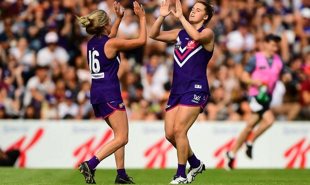 Stacey Barr celebrates a goal kicked against Brisbane during the 2017 AFLW season. - Fremantle,Fremantle Dockers,AFLW